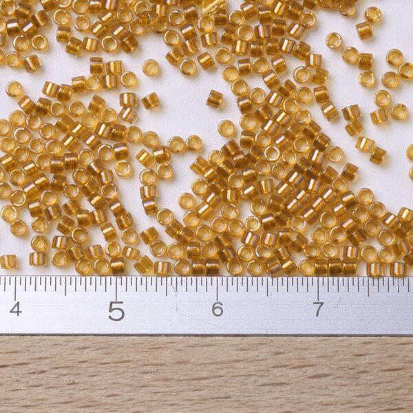 3f65cf98aca8d4f2affe6067d75b9785 MIYUKI DB0065 Delica Beads 11/0 - Transparent Topaz Yellow Lined, 100g/bag